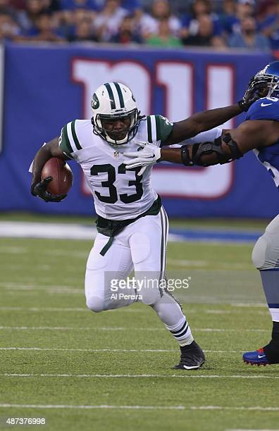 Running Back Chris Ivory of the New York Jets has a long gain against the New York Giants at MetLife Stadium on August 29, 2015 in East Rutherford,...