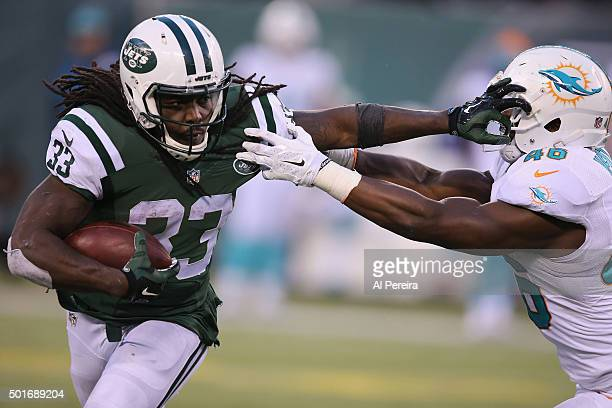Running Back Chris Ivory of the New York Jets has a long gain against the Miami Dolphins at MetLife Stadium on November 29, 2015 in East Rutherford,...