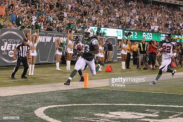 Running Back Chris Ivory of the New York Jets has a Touchdown against the Atlanta Falcons at MetLife Stadium on August 21, 2015 in East Rutherford,...