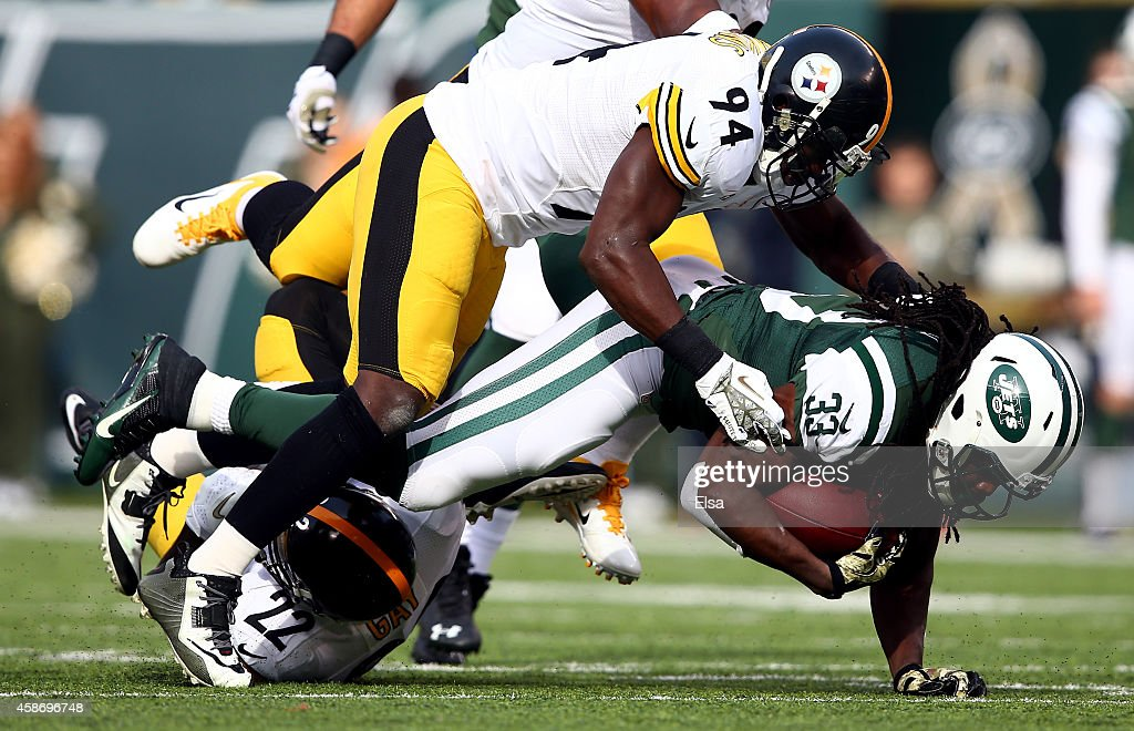 Running back Chris Ivory #33 of the New York Jets is tackled by inside linebacker Lawrence Timmons #94 of the Pittsburgh Steelers during a game at MetLife Stadium on November 9, 2014 in East Rutherford, New Jersey.