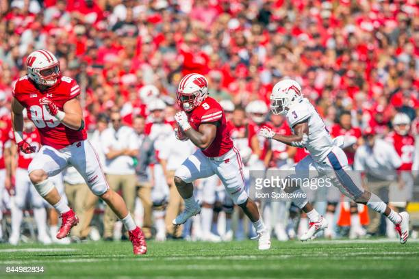 UW running back Chris James gains yards with a lead block from UW tight end Zander Neuville while FAU corner back Shelton Lewis pursues the action...