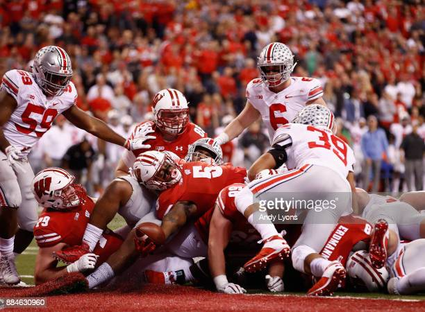 Running back Chris James of the Wisconsin Badgers makes a touchdown against the Ohio State Buckeyes during the Big Ten Championship game at Lucas Oil...