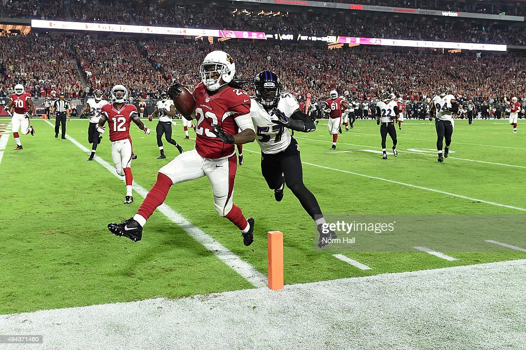 Running back Chris Johnson #23 of the Arizona Cardinals runs in a 26 yard touchdown against linebacker C.J. Mosley #57 of the Baltimore Ravens in the first quarter of the NFL game at University of Phoenix Stadium on October 26, 2015 in Glendale, Arizona.