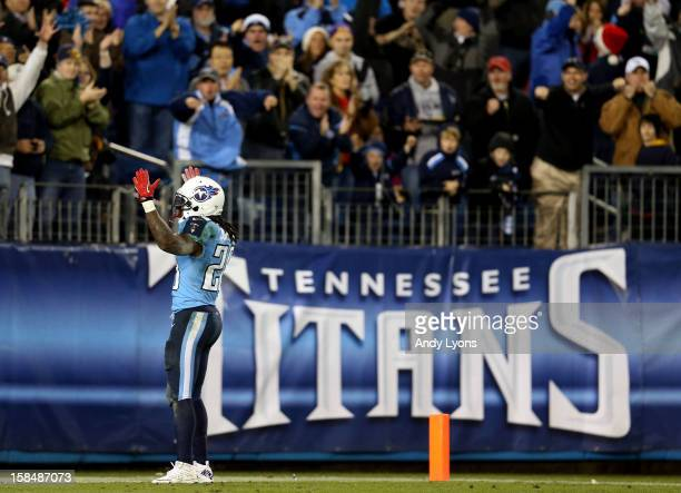 Running back Chris Johnson of the Tennessee Titans celebrates after scoring a touchdown in the second quarter against the New York Jets at LP Field...