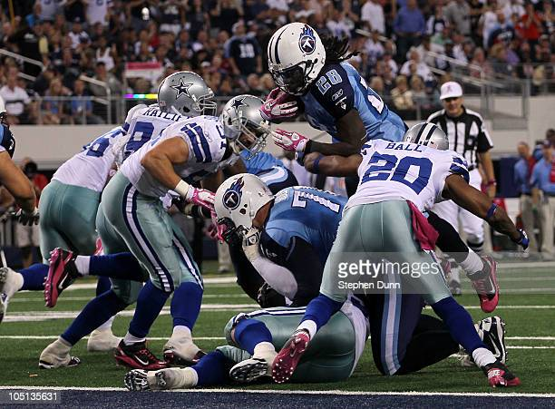 Running back Chris Johnson of the Tennessee Titans dives over the line to score the winning touchdown in the fourth quarter against the Dallas...