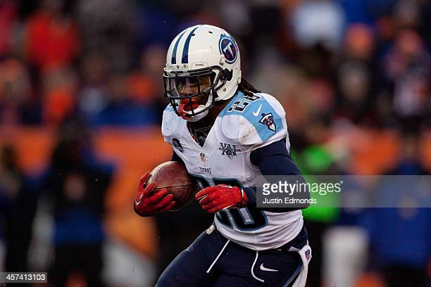 Running back Chris Johnson of the Tennessee Titans runs with the ball against the Denver Broncos at Sports Authority Field Field at Mile High on...