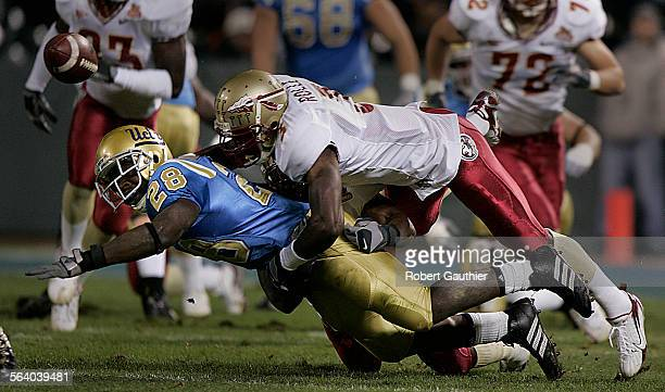 UCLA running back Chris Markey fumbles the ball after a hard tackle by Florida State defender Myron Rolle in the first half of the Emerald Bowl at...