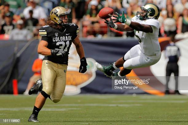 Running back Chris Nwoke of the Colorado State Rams is unable to make a pass reception as linebacker Jon Major of the Colorado Buffaloes defends in...