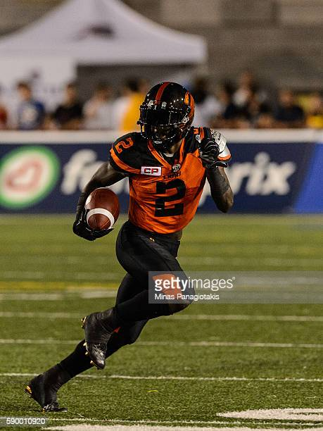 Running back Chris Rainey of the BC Lions runs with the ball during the CFL game against the Montreal Alouettes at Percival Molson Stadium on August...