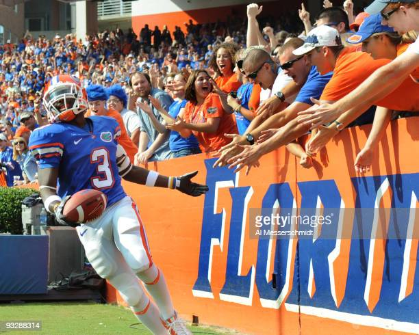 Running back Chris Rainey of the Florida Gators celebrates a touchdown run against the Florida International University Golden Panthers November 21...