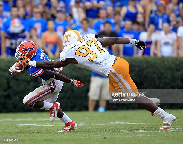 Running back Chris Rainey of the Florida Gators has his facemask grabbed by defensive lineman Malik Jackson of the Tennessee Volunteers during a game...