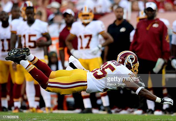 Running back Chris Thompson of the Washington Redskins dives for extra yards against the Buffalo Bills during a preseason game at FedExField on...