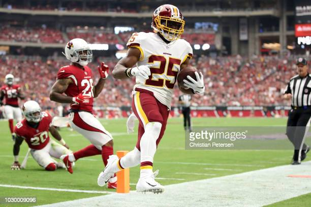 Running back Chris Thompson of the Washington Redskins runs for a 13yard touchdown during the second quarter against the Arizona Cardinals at State...