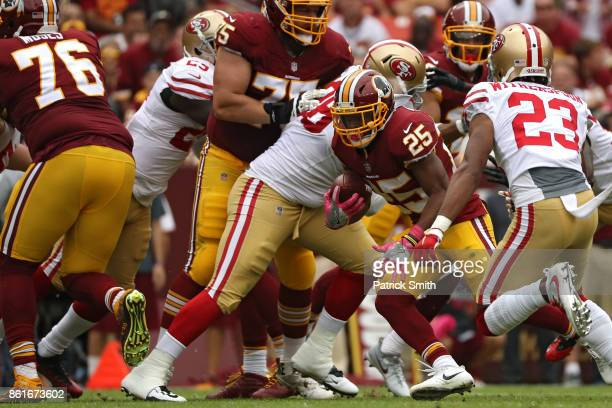 Running back Chris Thompson of the Washington Redskins rushes past Ahkello Witherspoon of the San Francisco 49ers during the first half at FedExField...