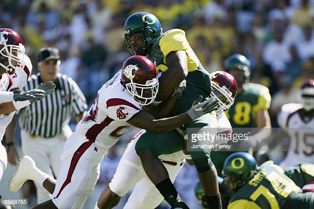Running back Chris Vincent of the University of Oregon Ducks is stopped by the Washington State University Cougars at Autzen Stadium on September 27...