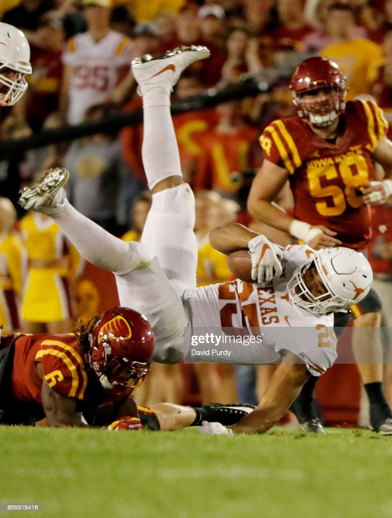Running back Chris Warren III #25 of the Texas Longhorns is tackled by defensive back De'Monte Ruth #6 of the Iowa State Cyclones as he rushed for yards in the first half of play at Jack Trice Stadium on September 28, 2017 in Ames, Iowa.