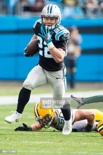 Running back Christian McCaffrey of the Carolina Panthers carries the ball against the Green Bay Packers during a NFL game at Bank of America Stadium...