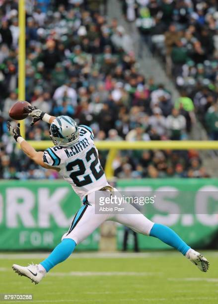 Running back Christian McCaffrey of the Carolina Panthers reaches for a catch during the second half of the game at MetLife Stadium on November 26...