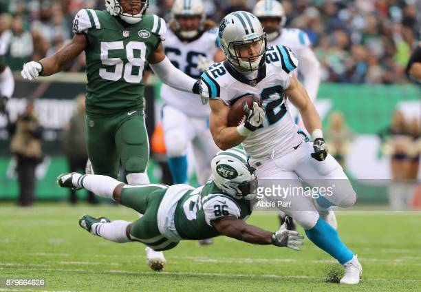 Running back Christian McCaffrey of the Carolina Panthers runs the ball against free safety Marcus Maye of the New York Jets during the first half of...