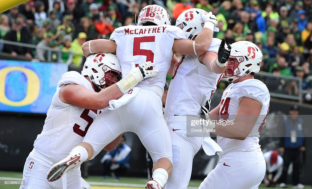 Running back Christian McCaffrey #5 of the Stanford Cardinal celebrates with teammates after scoring a touchdown during the first quarter of the game against the Oregon Ducks at Autzen Stadium on November 12, 2016 in Eugene, Oregon.