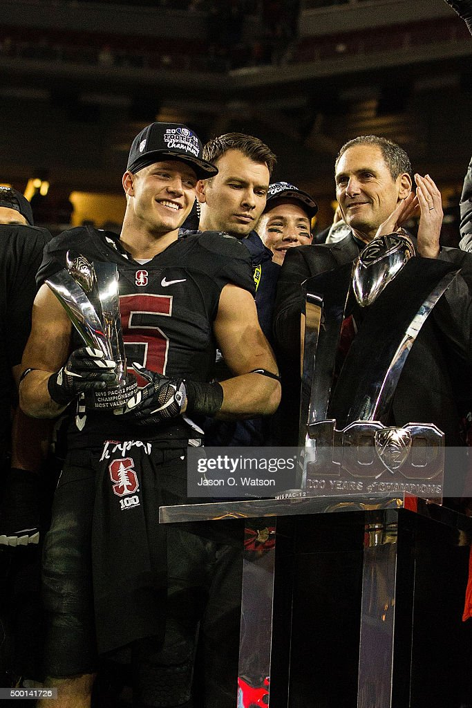 Running back Christian McCaffrey #5 of the Stanford Cardinal is presented with the MVP trophy by commissioner Larry Scott after the Pac-12 Championship game against the USC Trojans at Levi's Stadium on December 5, 2015 in Santa Clara, California. The Stanford Cardinal defeated the USC Trojans 41-22.