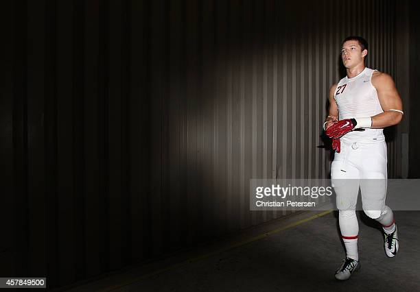 Running back Christian McCaffrey of the Stanford Cardinal walks to the field before the college football game against the Arizona State Sun Devils at...