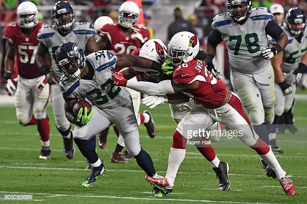 Running back Christine Michael of the Seattle Seahawks carries the football against defensive back DJ Swearinger of the Arizona Cardinals and another...