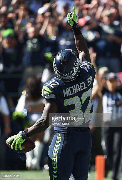 Running back Christine Michael of the Seattle Seahawks celebrates after scoring a touchdown against the San Francisco 49ers during the first quarter...