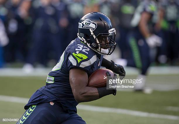 Running back Christine Michael runs with the ball during the second half of a football game against the Cleveland Browns at CenturyLink Field on...