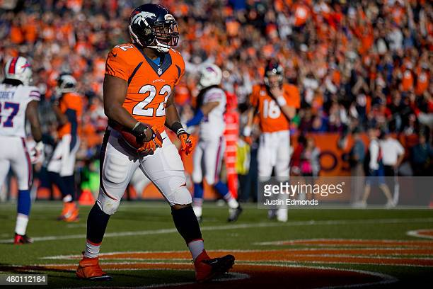 Running back CJ Anderson of the Denver Broncos celebrates a first quarter rushing touchdown against the Buffalo Bills at Sports Authority Field Field...