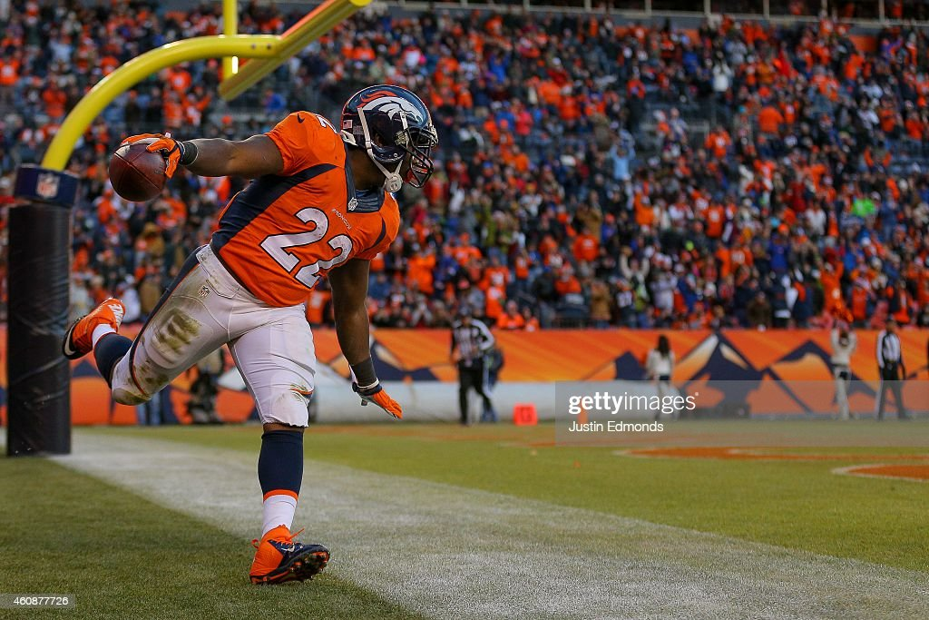 Running back C.J. Anderson #22 of the Denver Broncos celebrates a third quarter rushing touchdown against the Oakland Raiders (his third of the game) at Sports Authority Field at Mile High on December 28, 2014 in Denver, Colorado.