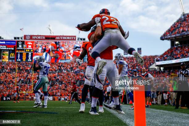 Running back CJ Anderson of the Denver Broncos celebrates a third quarter touchdown with teammates during a game against the Dallas Cowboys at Sports...