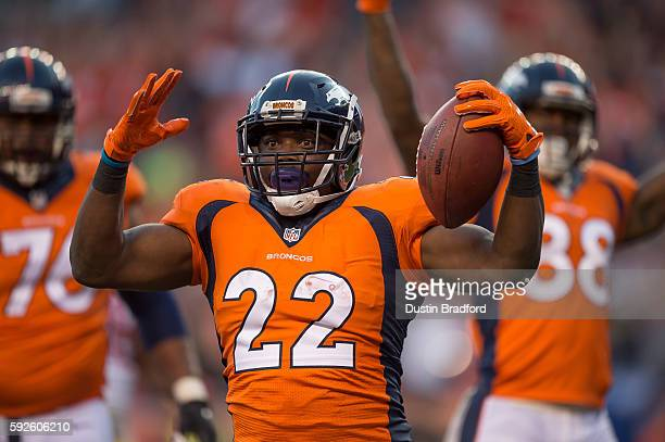 Running back CJ Anderson of the Denver Broncos celebrates after scoring a first quarter rushing touchdown against the San Francisco 49ers during a...
