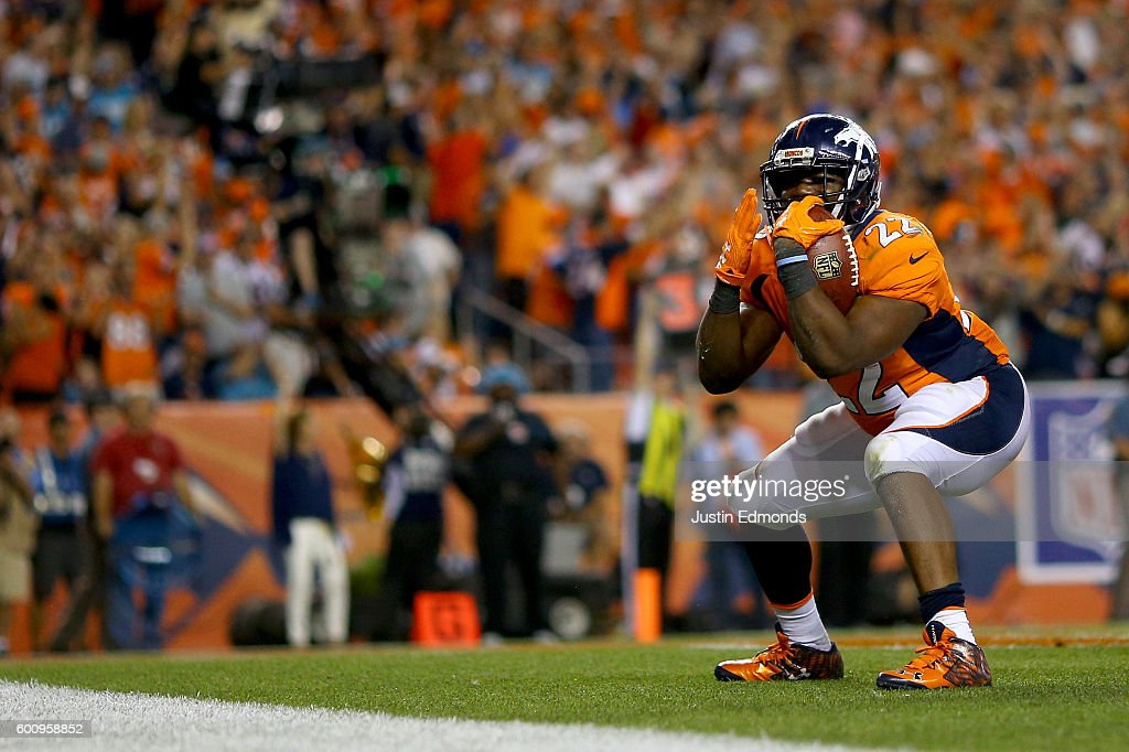 Running back C.J. Anderson #22 of the Denver Broncos celebrates after scoring on a one-yard touchdown run in the fourth quarter against the Carolina Panthers at Sports Authority Field at Mile High on September 8, 2016 in Denver, Colorado.