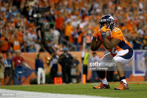 Running back CJ Anderson of the Denver Broncos celebrates after scoring on a oneyard touchdown run in the fourth quarter against the Carolina...