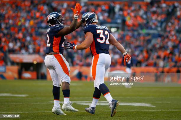 Running back CJ Anderson of the Denver Broncos congratulates Andy Janovich on his touchdown during the third quarter against the New York Jets at...