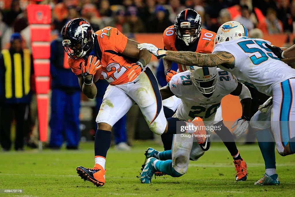 Running back C.J. Anderson #22 of the Denver Broncos has a fourth quarter rushing touchdown against the Miami Dolphins during a game at Sports Authority Field at Mile High on November 23, 2014 in Denver, Colorado.