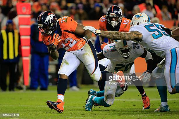 Running back CJ Anderson of the Denver Broncos has a fourth quarter rushing touchdown against the Miami Dolphins during a game at Sports Authority...