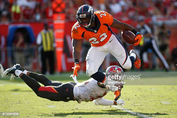 Running back CJ Anderson of the Denver Broncos is stopped short of a first down by free safety Bradley McDougald of the Tampa Bay Buccaneers during...