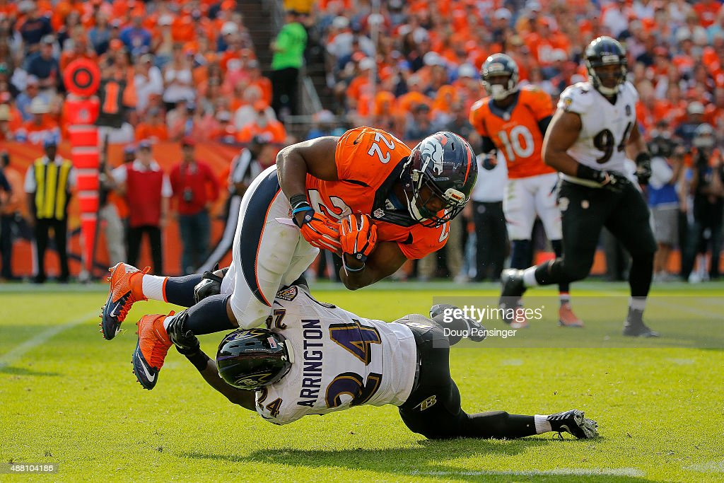 Running back C.J. Anderson #22 of the Denver Broncos is tackled by defensive back Kyle Arrington #24 of the Baltimore Ravens in the third quarter of a game at Sports Authority Field at Mile High on September 13, 2015 in Denver, Colorado.