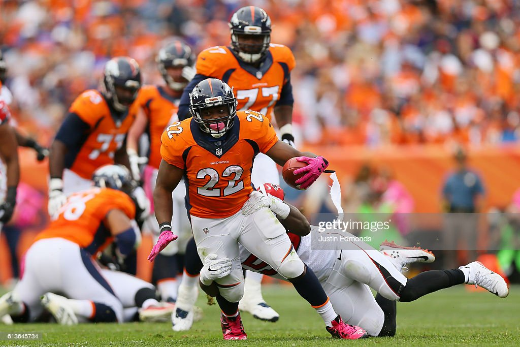 Running back C.J. Anderson #22 of the Denver Broncos is tackled in the second half at Sports Authority Field at Mile High on October 9, 2016 in Denver, Colorado.