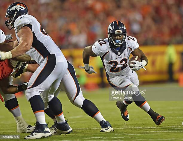 Running back CJ Anderson of the Denver Broncos runs up field against the Kansas City Chiefs during the first half at Arrowhead Stadium on September...