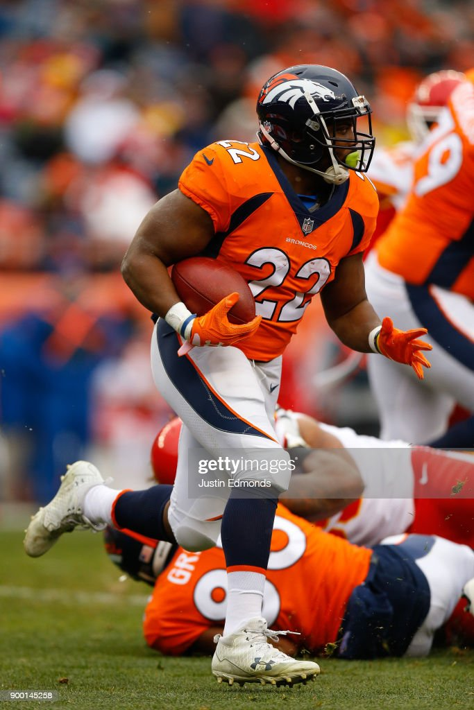 Running back C.J. Anderson #22 of the Denver Broncos runs with the football during the first quarter against the Kansas City Chiefs at Sports Authority Field at Mile High on December 31, 2017 in Denver, Colorado.