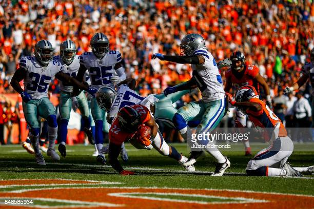 Running back CJ Anderson of the Denver Broncos rushes after a catch for a second quarter touchdown against the Dallas Cowboys at Sports Authority...