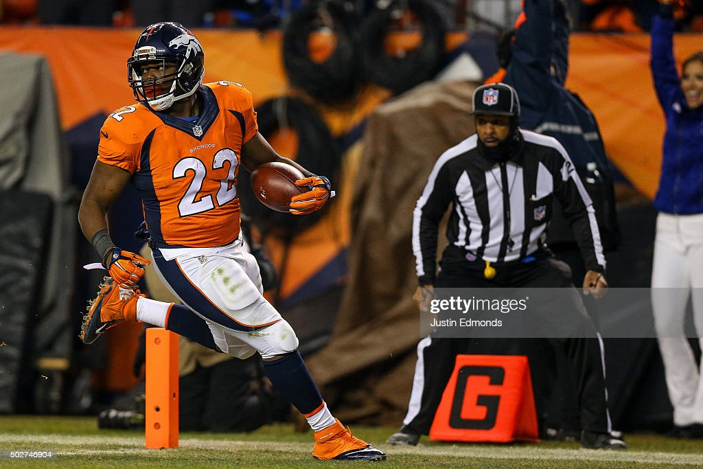 Running back C.J. Anderson #22 of the Denver Broncos rushes for a 39 yard fourth quarter go-ahead touchdown during a game at Sports Authority Field at Mile High on December 28, 2015 in Denver, Colorado..