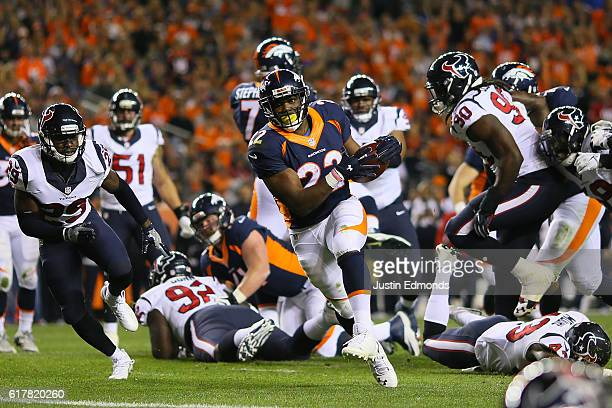 Running back CJ Anderson of the Denver Broncos rushes for a touchdown in the second quarter of the game against the Houston Texans at Sports...