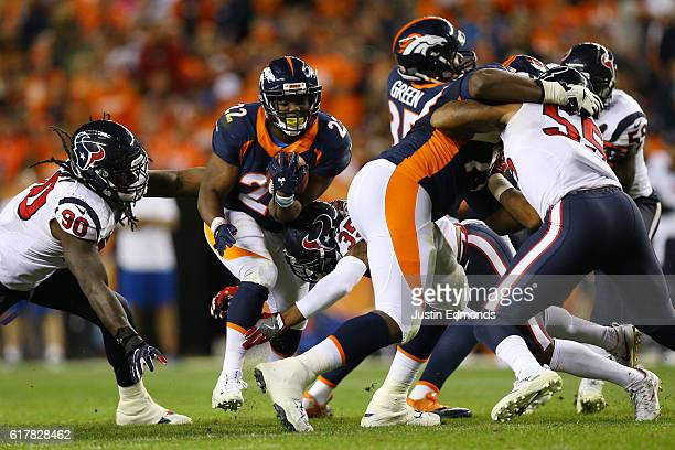 Running back CJ Anderson of the Denver Broncos rushes in the fourth quarter of the game against the Houston Texans at Sports Authority Field at Mile...