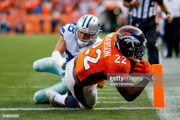 Running back CJ Anderson of the Denver Broncos rushes past strong safety Jeff Heath of the Dallas Cowboys for a third quarter touchdown at Sports...