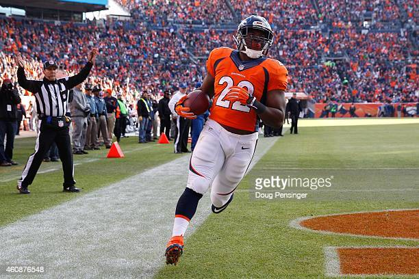 Running back CJ Anderson of the Denver Broncos scores a second quarter touchdown for his second touchdown of the game on a 1yard rush against the...