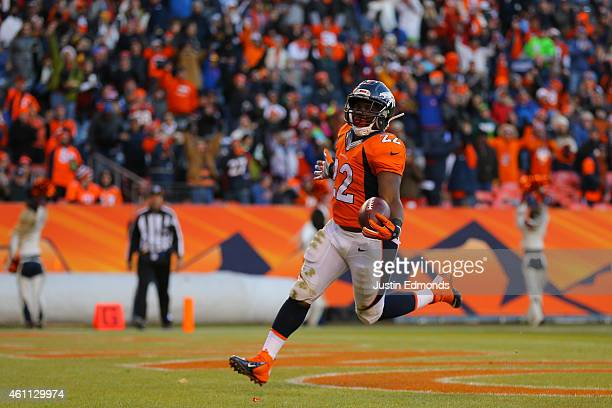 Running back CJ Anderson of the Denver Broncos scores a touchdown against the Oakland Raiders at Sports Authority Field at Mile High on December 28...